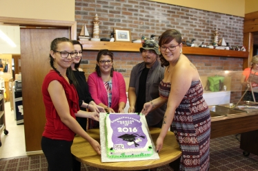 group holding cake