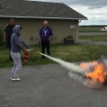 Scott Maracle, Fire Chief of the Mohawks of the Bay of Quinte, teaches proper fire suppression techn